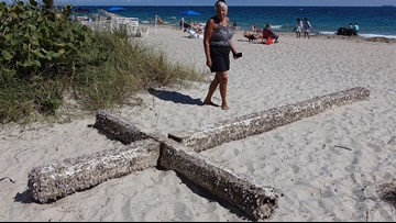 Sign from the sea: Giant cross washes ashore behind hotel