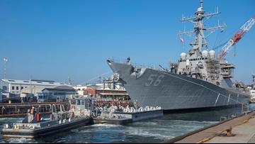 USS John S. McCain returns to the water following deadly collision