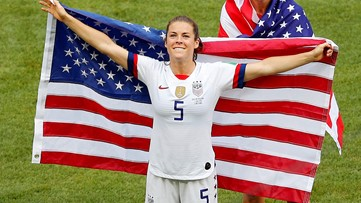 Kelley O'Hara wins over the internet with US flag rescue, post-game kiss